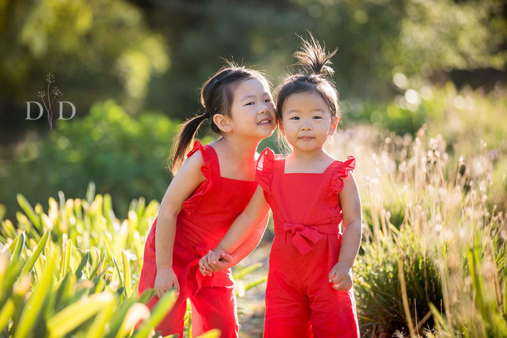 Family Photo, two daughters in red