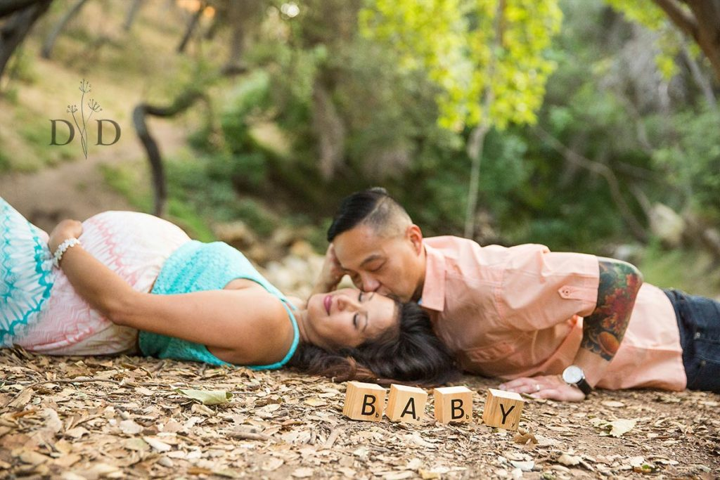 Maternity Photos Laying on Ground