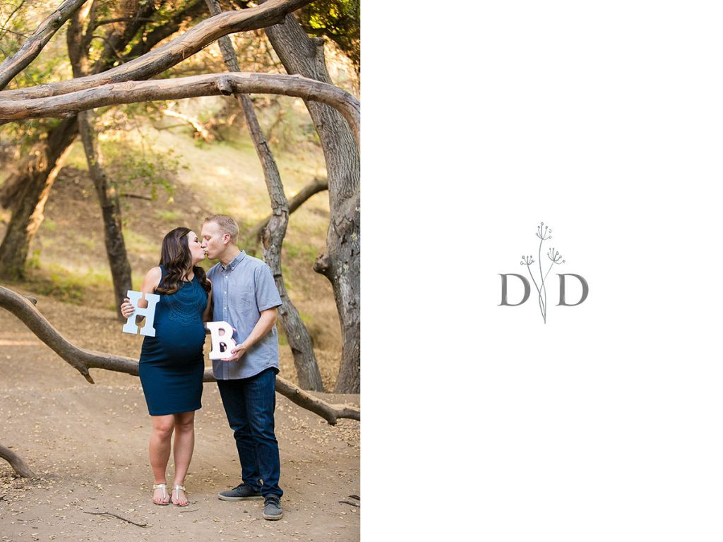 Maternity Photos Holding Up Letters