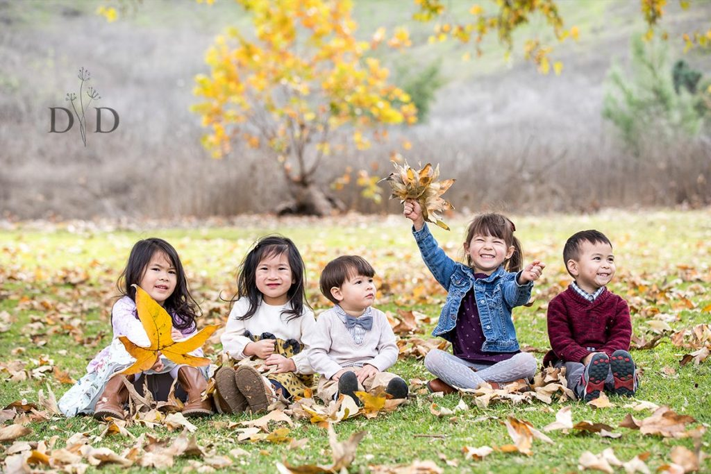 Grandkids playing with leaves