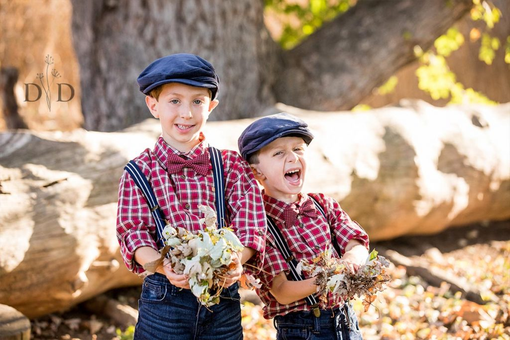 Two Brothers Throwing Leaves