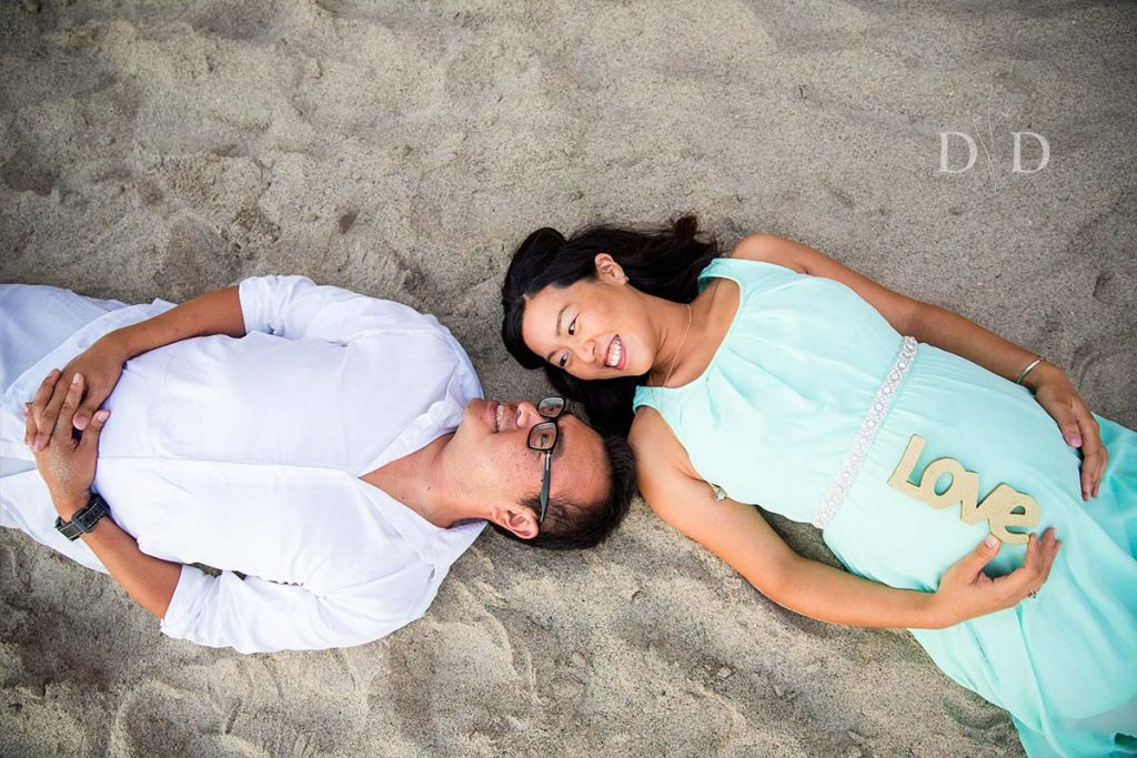 Maternity Photography on the sand of the beach
