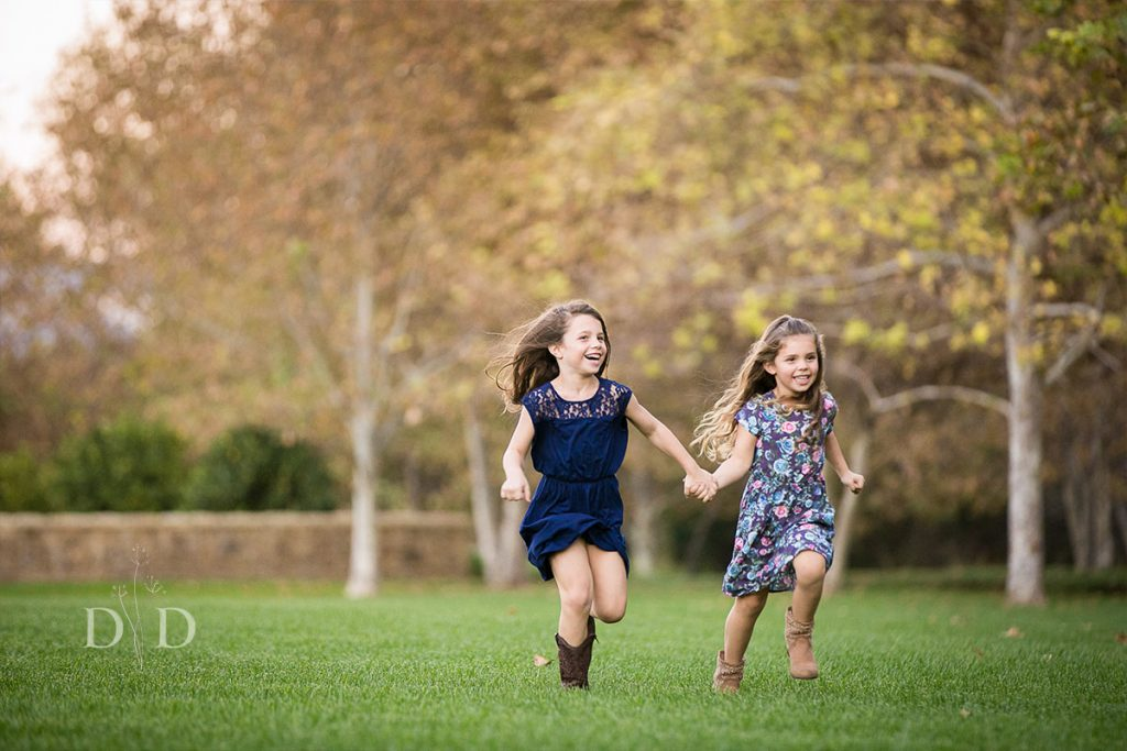 Two Sisters Running Together