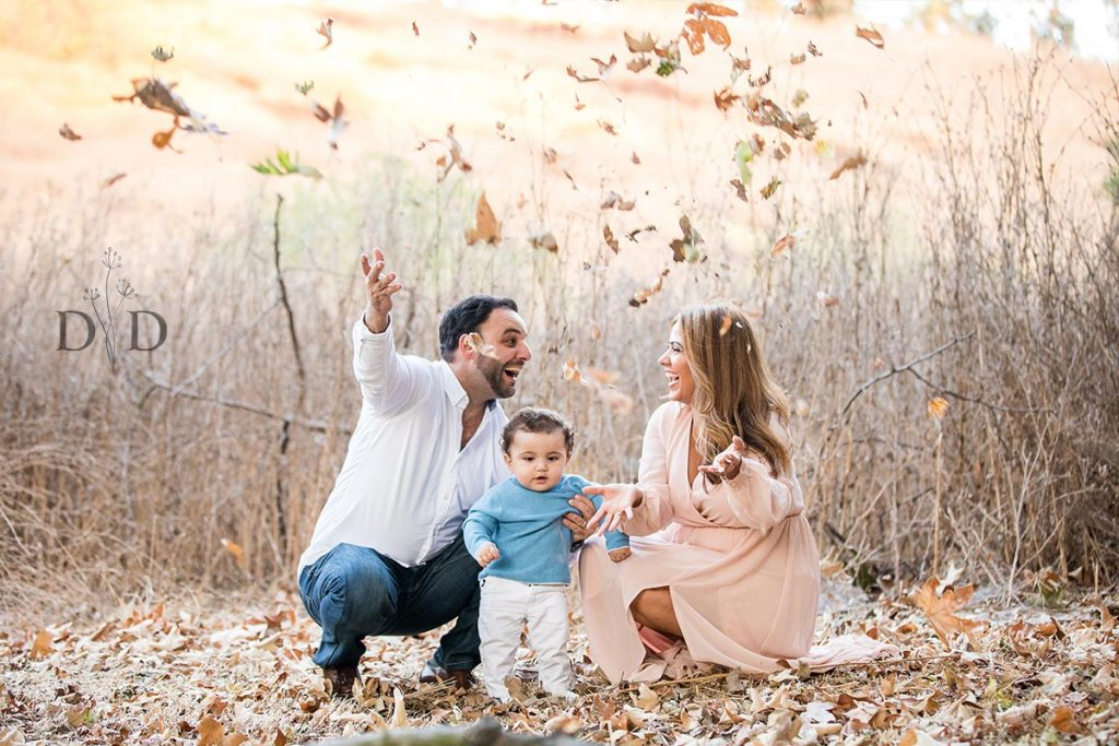Family Photo Throwing Leaves in Air