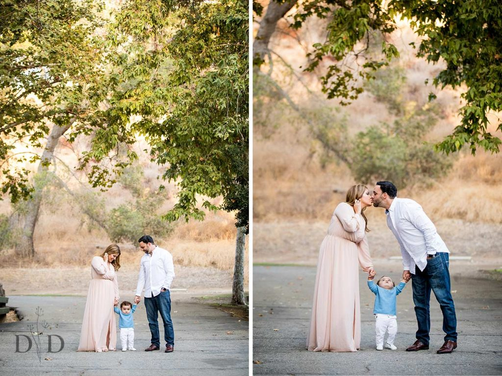 Mom and Dad Kissing with Infant