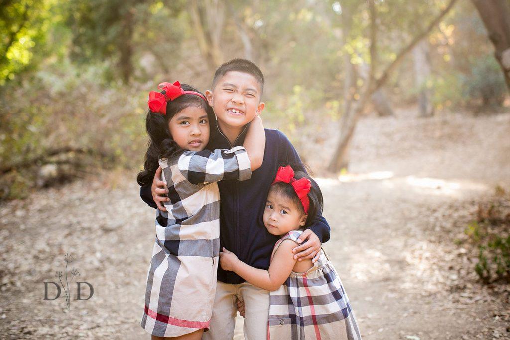 Three Siblings Hugging Family Photos