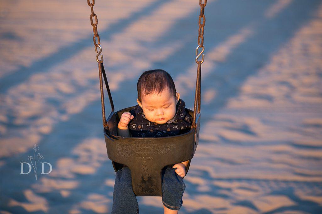 Little Boy in Swing at Beach