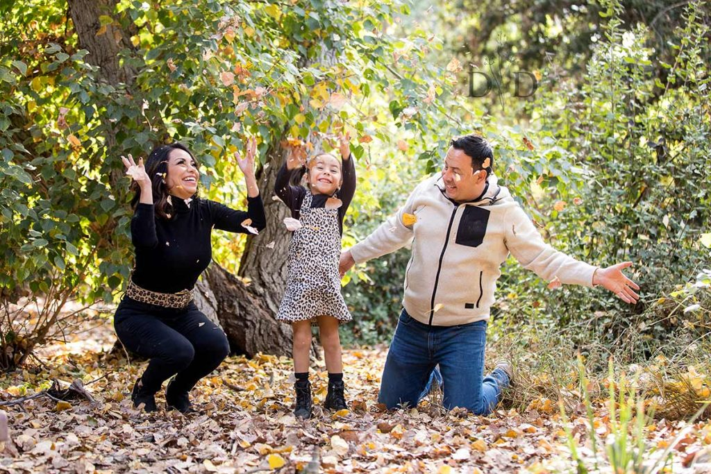 Claremont Family Photo Throwing Leaves