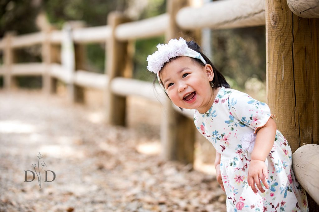 Family Portrait of Cute Daughter by Fence